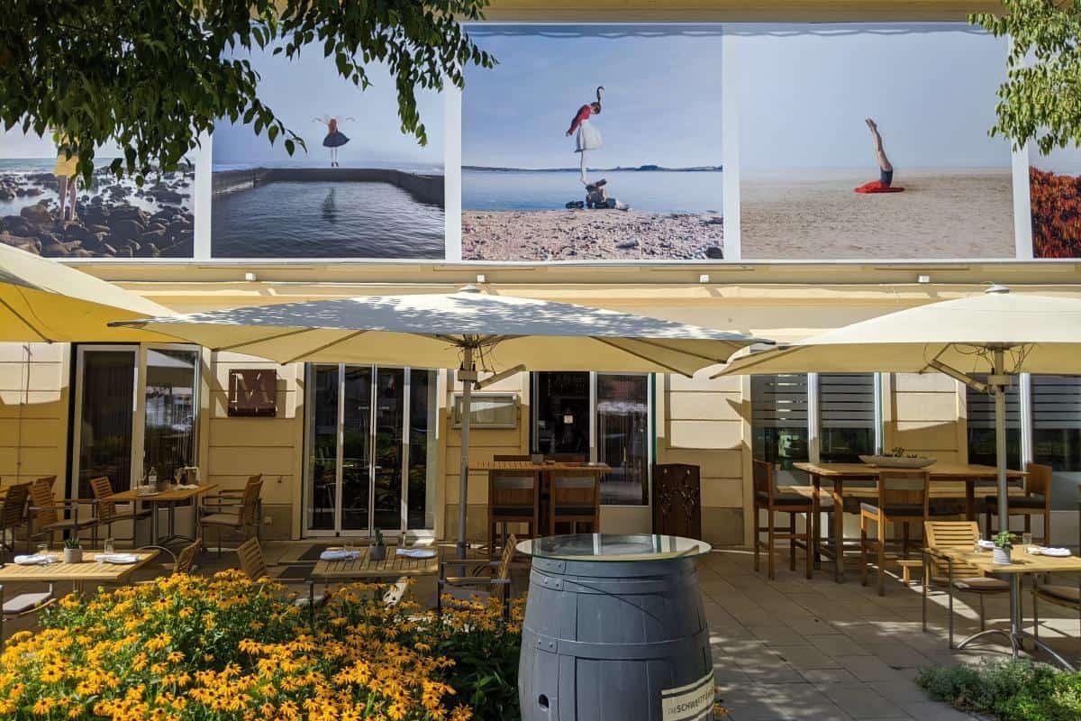 Fotos des La Gacilly Baden auf einer Häuserwand